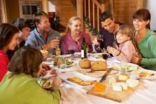 Family celebrating in mountain home.